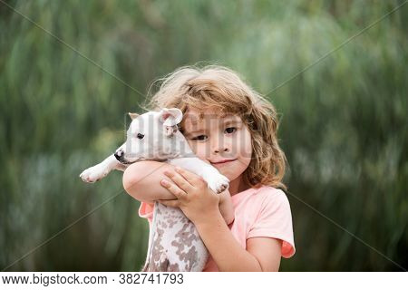 Hug Friends. Happy Child And Dog Hugs Her With Tenderness Smiling