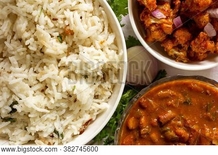 Indian Pulao With Fried Cauliflower Appetizer And Kidney Beans Gravy