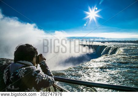 Niagara falls, Canada-Oct 28, 2019: People over Niagara Falls on a beautiful sunny day. Canada site, Canadian view. Niagara Falls are three waterfalls at the southern end of Niagara Gorge