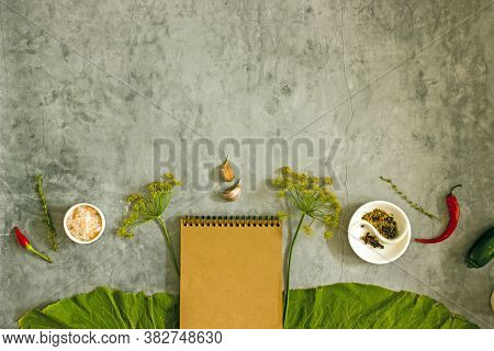 Pickled Cucumbers Jar Background Frame Copy Space. Jar With Canned Cucumbers, Fresh Herbs, Pepper Po