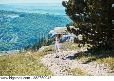 Sports Workout. Morning Running Outdoors. Sport, Fitness. Sporty Woman Running Along Forest Trail. M