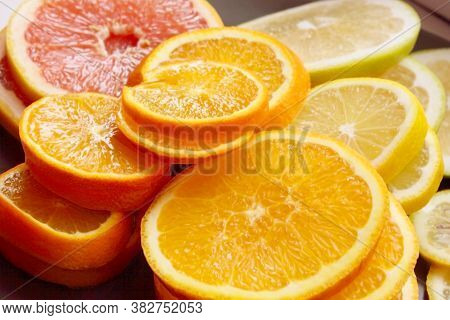 Grapefruit, Orange, Lime, Tangerine, Lemon Slices. The Background Is Made Of Citrus Fruits. Slices O