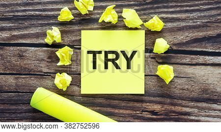 Try . Notes About Try Concept On Yellow Stickers On Wooden Background