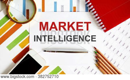 Text Market Intelligence On The Notepad With Office Tools, Pen On Financial Report