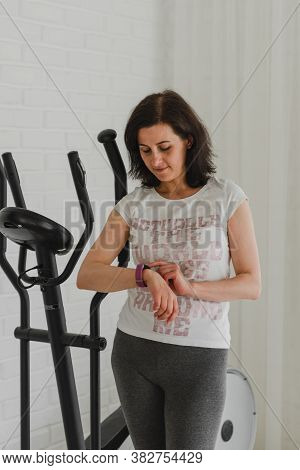 Woman Is Engaged In A Sports Simulator For Running,middle-aged Woman Goes In For Sports On A Sports