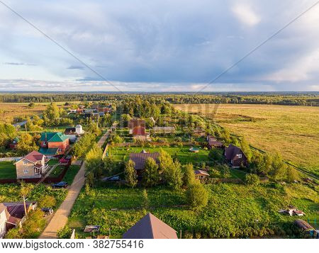 Suburban Summer Landscape With A Birds Eye View. Horizon Line With Fluffy Clouds.