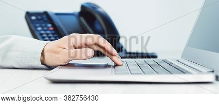 Business And Communications. Female Hand And Voip Phone In The Office, Close Up Of Hand. Finance Gra