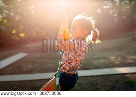 Happy Kid Enjoying Activity In A Climbing Adventure Park.