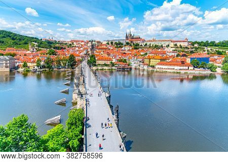 Prague Panorama With Prague Castle, And Charles Bridge Over Vltava River. View From Old Town Bridge