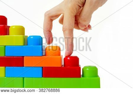 Step By Step To The Top. Business Concept Of Successful Financial Growth. The Womans Hand Steps On T
