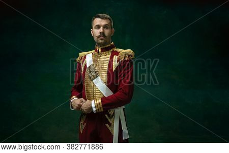 Thoughtful. Young Man In Suit As Nicholas Ii Isolated On Dark Green Background. Retro Style, Compari