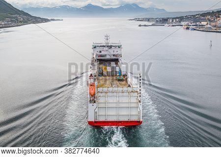 Container Ship Passing The Bridge Of Tromso Norway