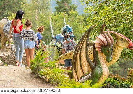 Juberri Sant Julia De Loria, Andorra: August 27 2020: Family Enjoying Of Sculptures In Jardins De Ju