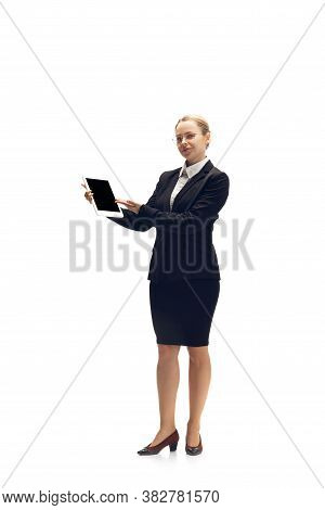 Pointing On Blank Screen. Young Woman, Accountant, Finance Analyst Or Booker In Office Suit Isolated