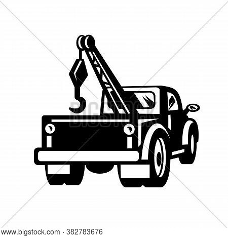 Black And White Illustration Of A Vintage Tow Truck Or Wrecker Pick-up Truck Lorry Viewed From Rear