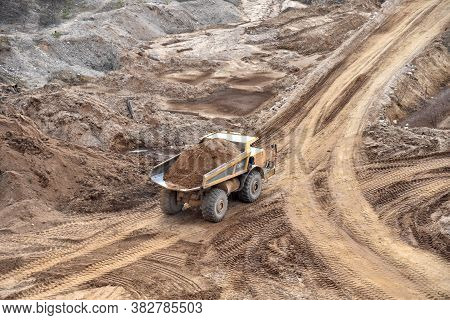 Mining Truck Transportion Minerals And Sand In The Open-pit. Heavy Machinery Working In The Mining Q