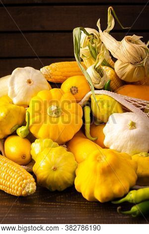 Fresh Harvest Of Zucchini And Pattypan Squash, Yellow Squash And Corn Cob And Pepper On Wooden Backg