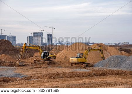 Group Of The Excavators For Dig Ground Trenching At A Construction Site For Foundation And Installin
