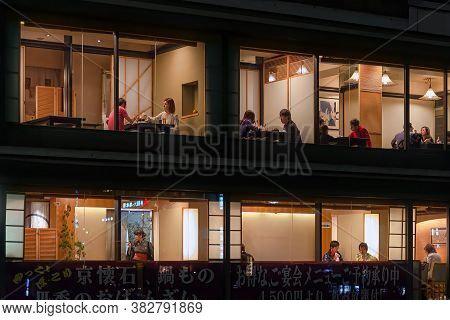 Kyoto, Japan - April 23, 2014: Couples Enjoy Dinner In Exclusive Restaurant In Pontocho Alley. Ponto