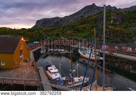 Nusfjord, Norway - August 20, 2016: View Of The Harbor Under Dramatic Sky. Nusfjord Is One Of The Ol
