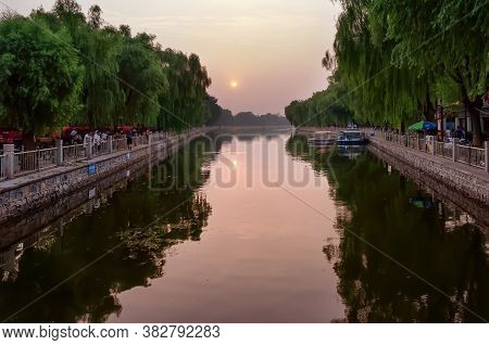 Beijing, China - August 8, 2011: Houhai Lake View At Sunset From Yinding Bridge. Houhai Is A Lake An