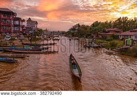 Nyaungshwe, Myanmar - December 26, 2019: View Of The River Channel And The Kayaks Port At Sunset. Ny