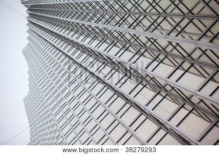 low angle shot of a tall commercial building with steel frames