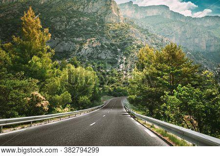 Beautiful Empty Asphalt Freeway, Motorway, Highway Against Mountains Background. Travel Road Concept