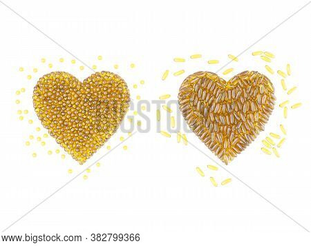 Two Hearts Made Of Round And Oblong Golden Capsules. 3d Rendering