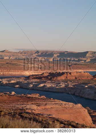 High Angle View Of Mountain Range And Water Stream With Clear Sky In Background