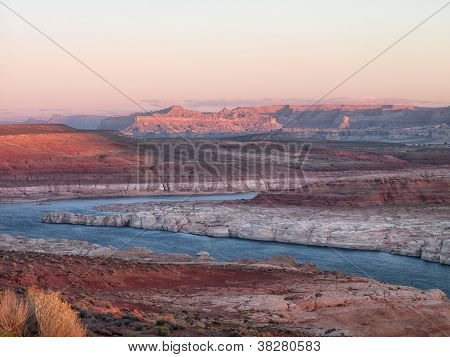 mountain range and water stream with clear sky in background