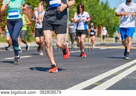 Marathon Runners On City Road. Running Competition. Street Sprinting Outdoor. Healthy Lifestyle, Fit