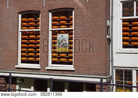 Delft, The Netherlands - August 5, 2020:  Windows With Ripening Dutch Cheeses In The City Of Delft.