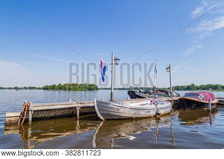 Sloops, Sailingboats And Motorboats Ready For Sailing Paterswoldsemeer A Lake Near Groningen In The