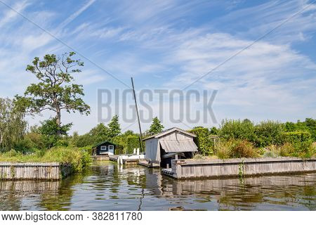 Wooden Boathouse And Summerhouse Along Paterswoldsemeer A Lake Near Groningen In The Netherlands On