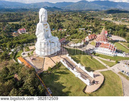 Aerial View Of Big Buddha (guan Yin Buddha) And 9 Floor Pagoda In Wat Huay Pla Kung Temple. Tourist