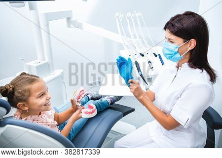 Happy Dentist And Child Communicate, Teeth Treatment Child. Childs Dentist While Working