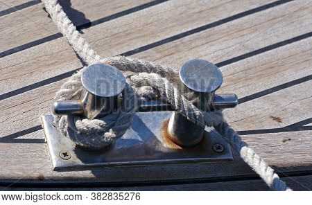 Ship Mooring Lines Attached To Bollard On Pier