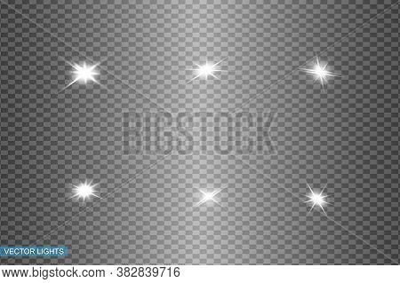 White Glowing Light Explodes On A Transparent Background. Sparkling Magical Dust Particles. Bright S