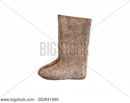 Old National Traditional Russian Winter Footwear - Felt Boot Isolated On White Background. Name Vale