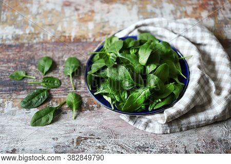 Baby Spinach Leaves On A Plate. Healthy Food Concept. Vegan Food. Green Salad Leaves.