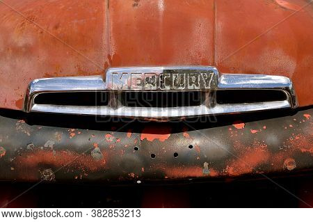 Lake Park, Minnesota, July 29, 2020: The Hood And Logo Of The Old Classic Car Is A Mercury, A Defunc