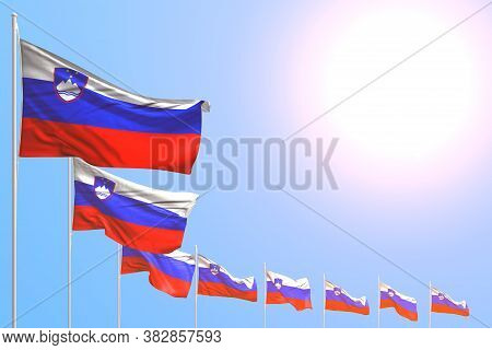 Pretty Many Slovenia Flags Placed Diagonal On Blue Sky With Space For Your Content - Any Holiday Fla