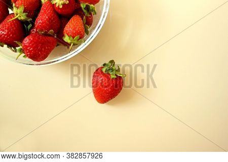 Fresh Ripe Delicious Strawberries In A Glass Plate On The Table. The Plate Is Not Completely, One St