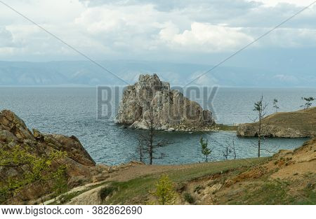 Shamanka Rock On Olkhon. One Of The Nine Holy Places Of Asia. Cape Burhan. Landscape Of Siberian Bai