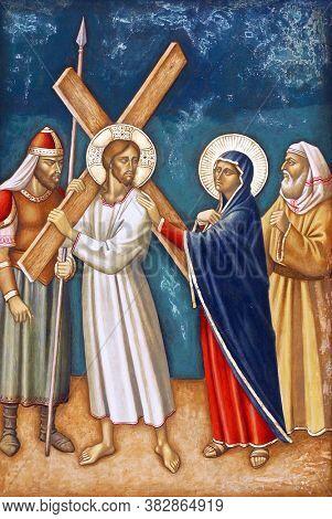 ZAGREB, CROATIA - FEBRUARY 19, 2013: 4th Stations of the Cross, Jesus meets His Mother, parish church Precious Blood of Jesus in Zagreb, Croatia