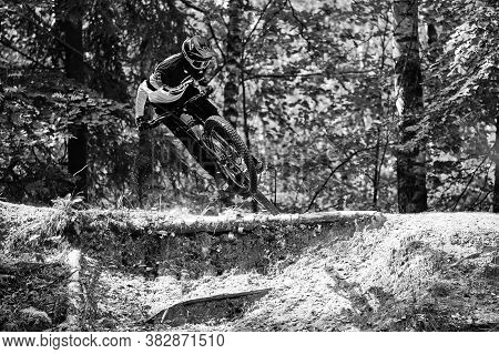 Russia, Moscow - August 29, 2020: Professional cyclist down hill riding. Biker riding in nature. Coo