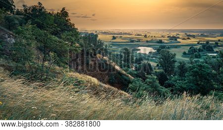 Impressive Summer Orange Sundown Sky, Landscape Of Empty Endless Farmland, Green Fields, Trees And S