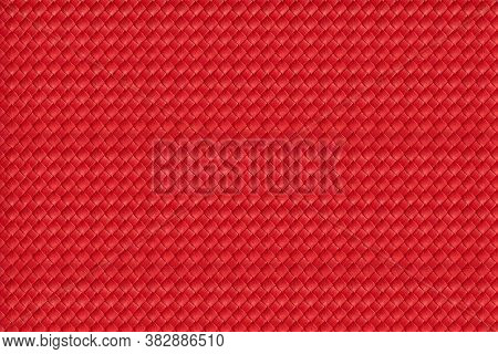 Red Leather Material Background. Upholstery. Texture. Close-up