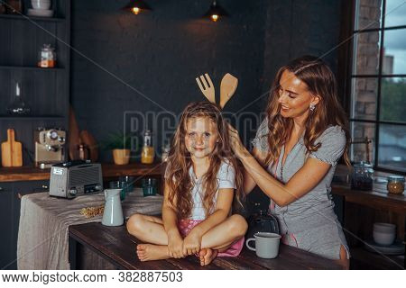 Happy Loving Family Preparing Dinner Together. Smiling Mom And Child Daughter Girl Cooking And Havin
